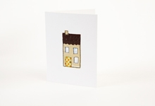 Embroidered house with green and orange polka-dot door greetings card