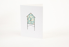 Embroidered blue flowers beach hut greetings card