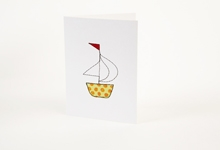 Embroidered green and orange polka-dot boat greetings card