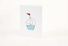 Embroidered blue and white polka-dot boat greetings card
