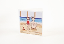 Father and daughter on the beach greetings card