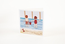 Children playing on the beach greetings card